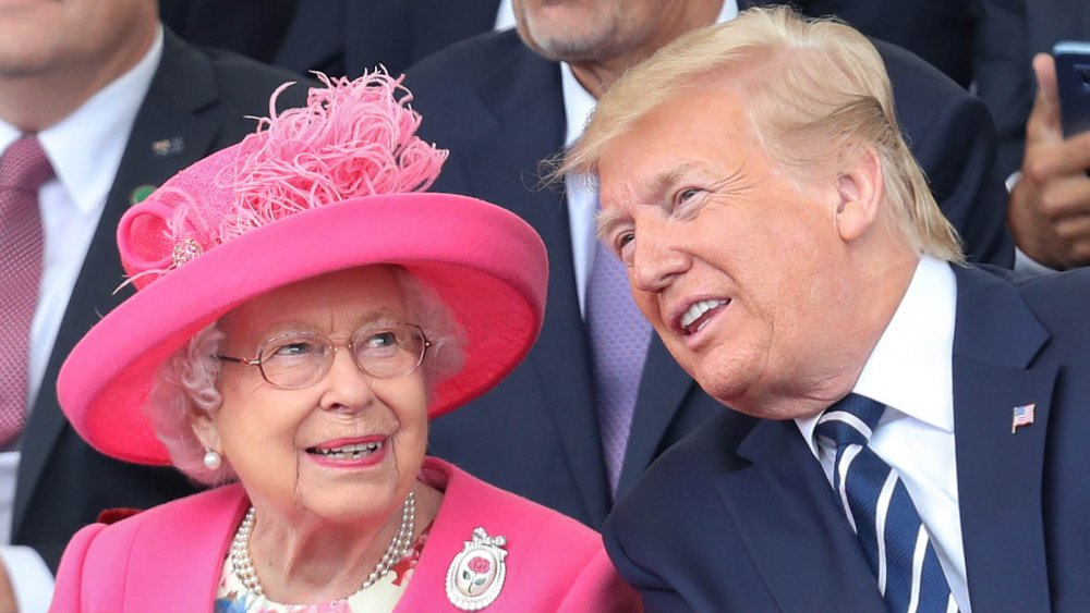 The Queen in a pink ensemble next to Donald Trump