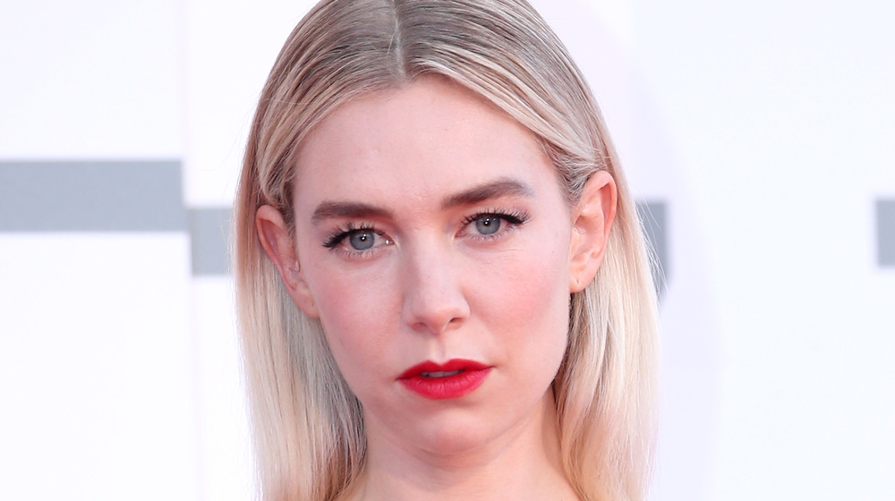 Vanessa Kirby wearing lipstick and her hair straight posing for cameras with a straight face