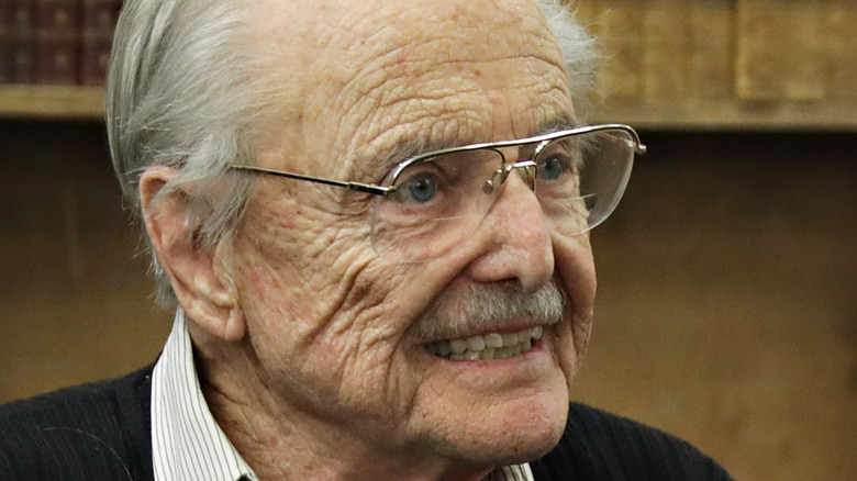 William Daniels smiling and signing copies of his book