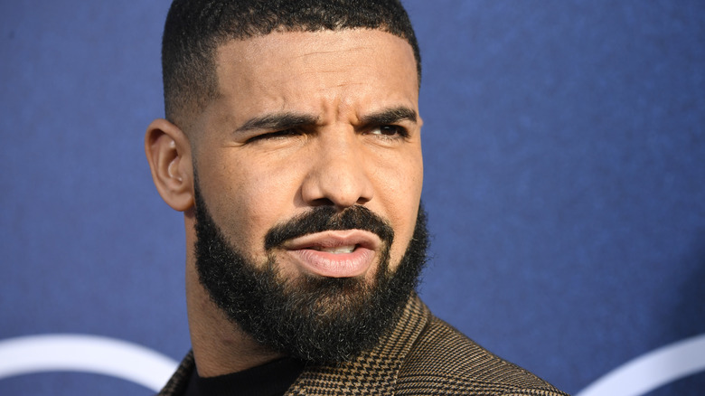 Drake looking to the side with confused expression