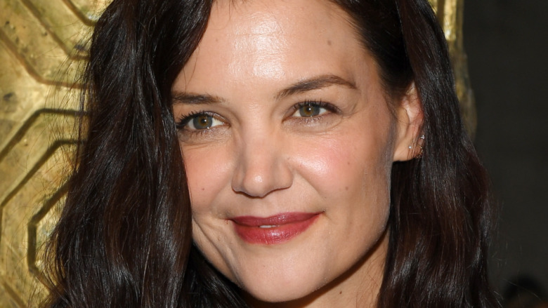 Katie Holmes smiling for photos