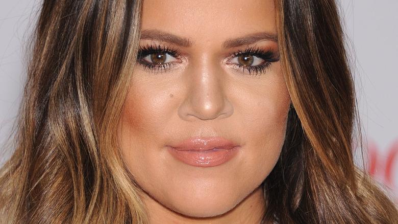 Khloe Kardashian with a neutral expression