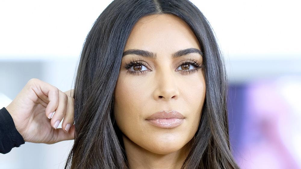Kim Kardashian posing with her hand on her head
