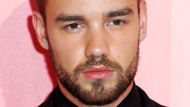 Liam Payne with a serious expression