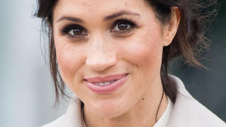 Meghan Markle smiling at camera