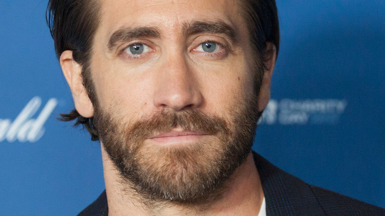Jake Gyllenhaal staring at camera with solemn expression