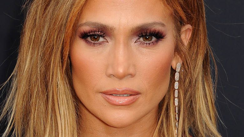 Jennifer Lopez with serious expression on red carpet