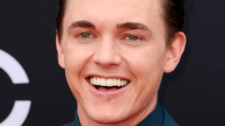 Jesse McCartney smiles on the red carpet