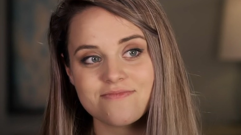 Jinger Duggar looking off to the side