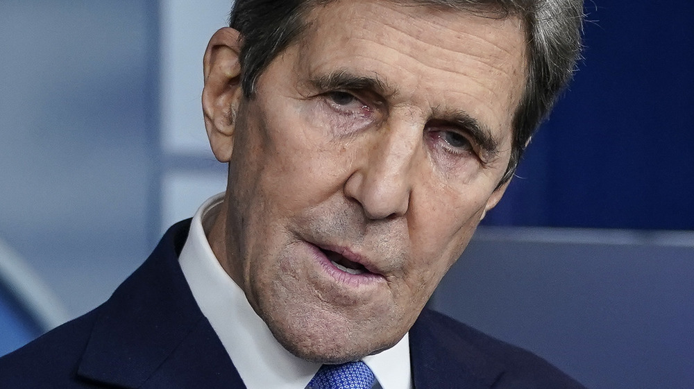 John Kerry looking serious at the podium