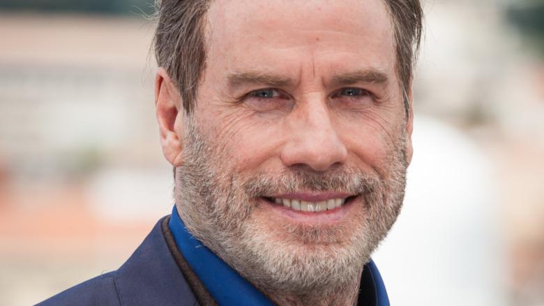John Travolta smile