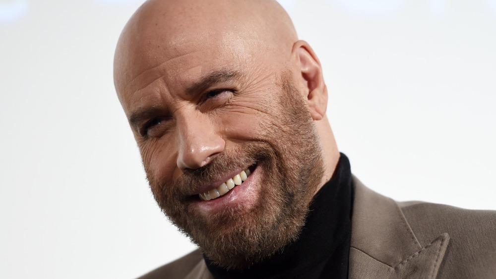 John Travolta smiling at an event