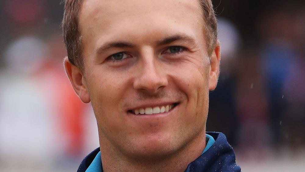 Jordan Spieth smiling at a golfing event