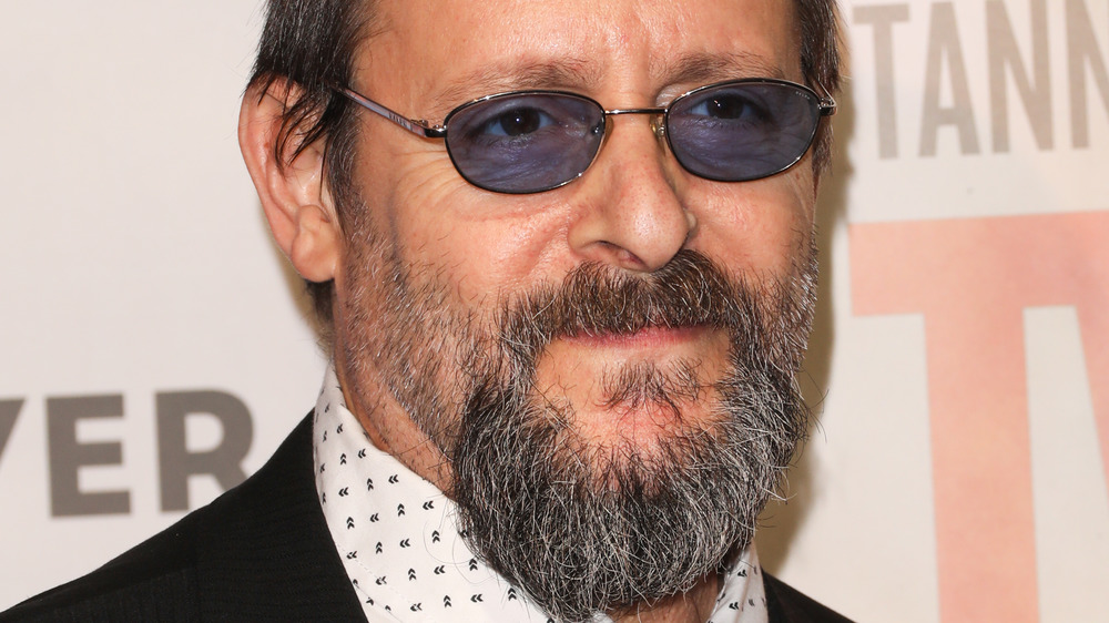 Judd Nelson staring with glasses