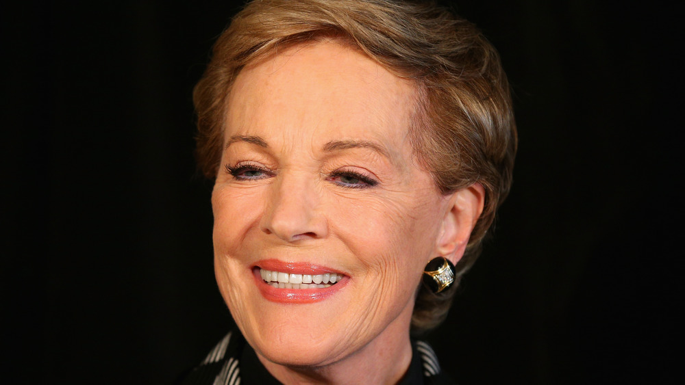 Julie Andrews smiles for the camera at an event