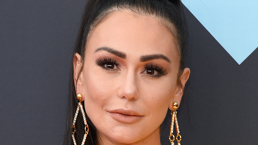 Jenni 'JWoww' Farley posing at a red carpet event
