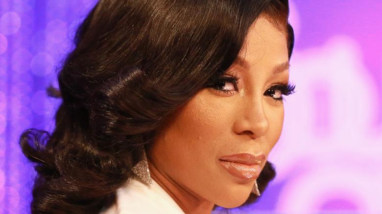 K Michelle wearing black hair