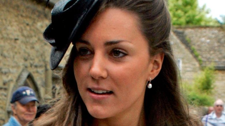 Kate Middleton wearing a black hat in 2005