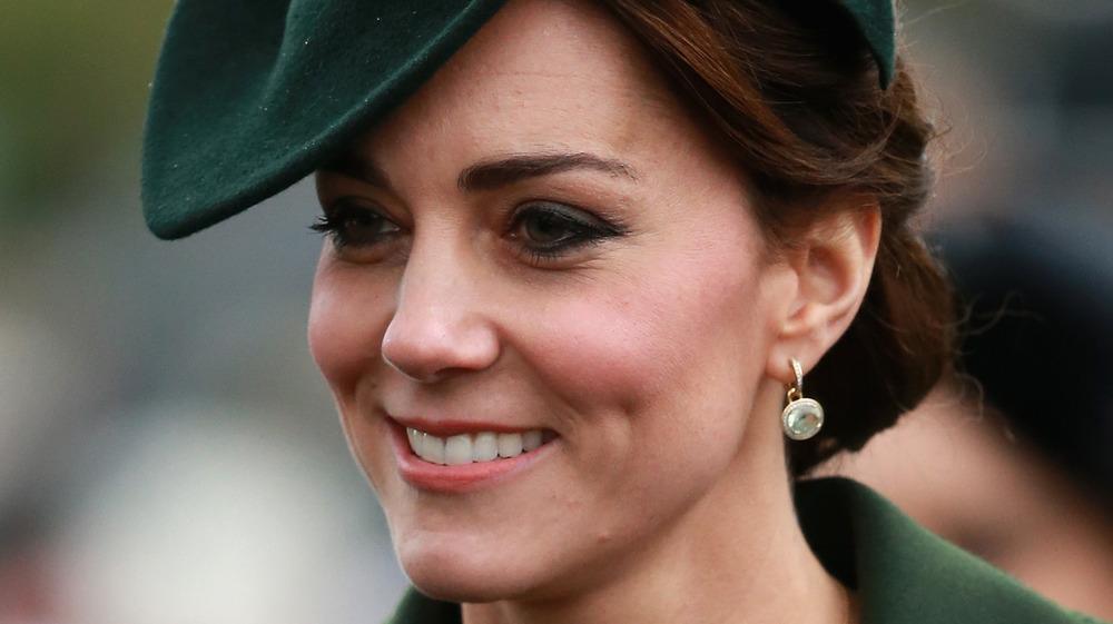 Kate Middleton smiling in green