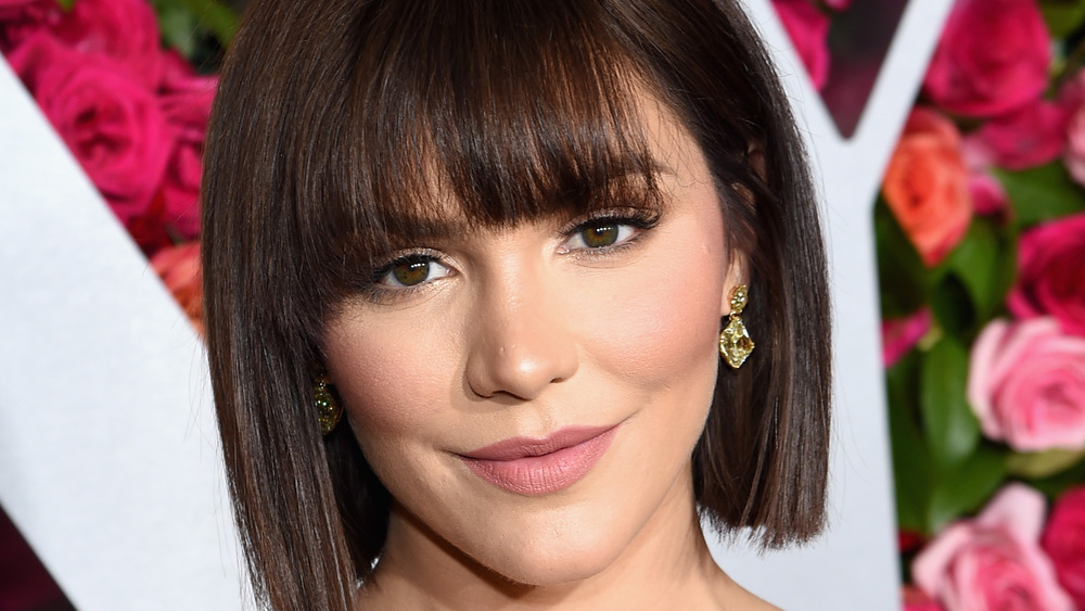 Katharine McPhee with bangs posing at an event