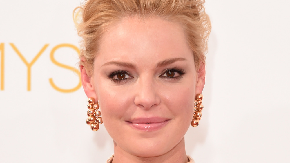 Katherine Heigl smiles for a photo on the red carpet