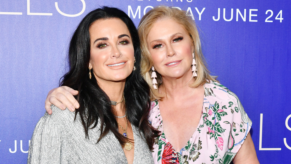 Kyle Richards and Kathy Hilton, smiling while posing arm in arm