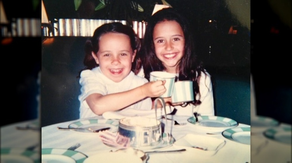 Carrie and Ellie Monahan have a tea party as kids
