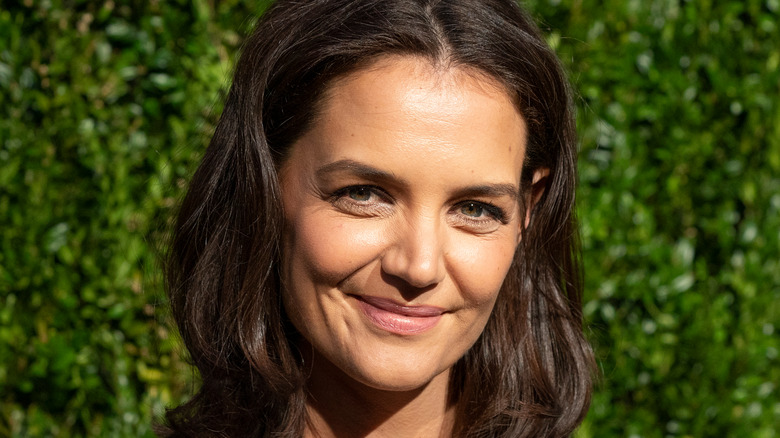 Katie Holmes smiling at an event