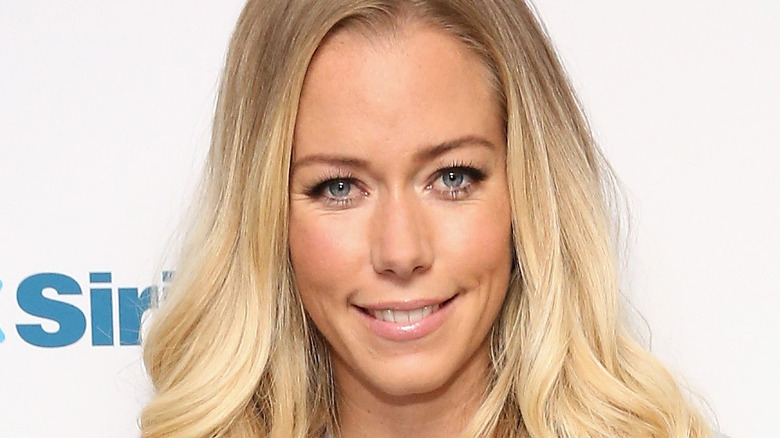 Kendra Wilkinson smiling at an event