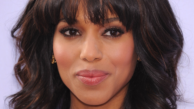 Kerry Washington smiling and looking to her left wearing bangs