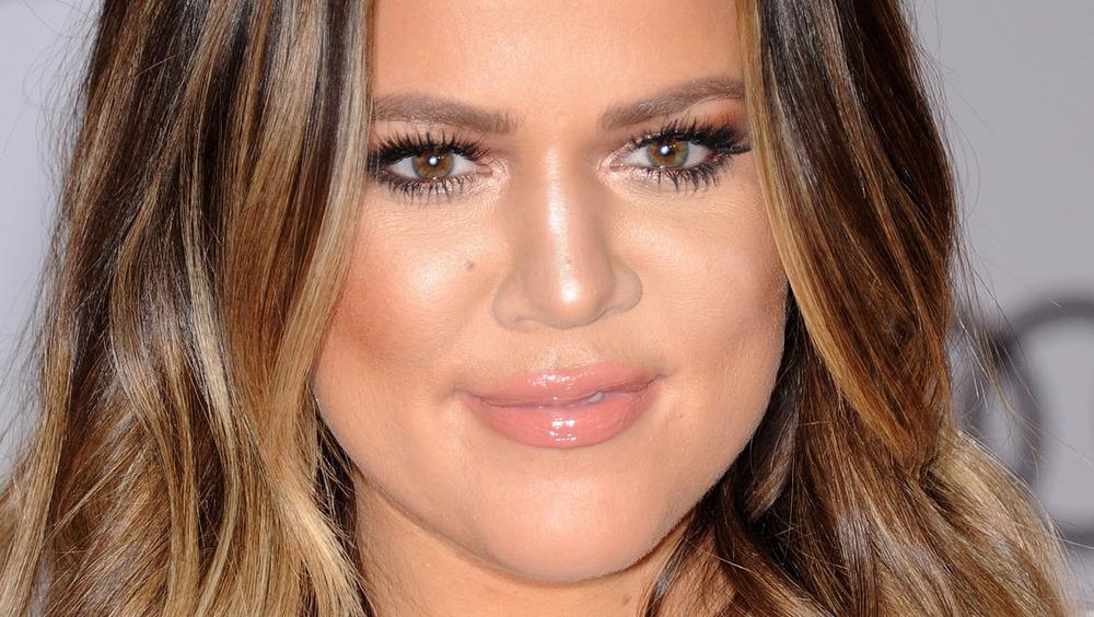 Khloe Kardashian smiling slightly