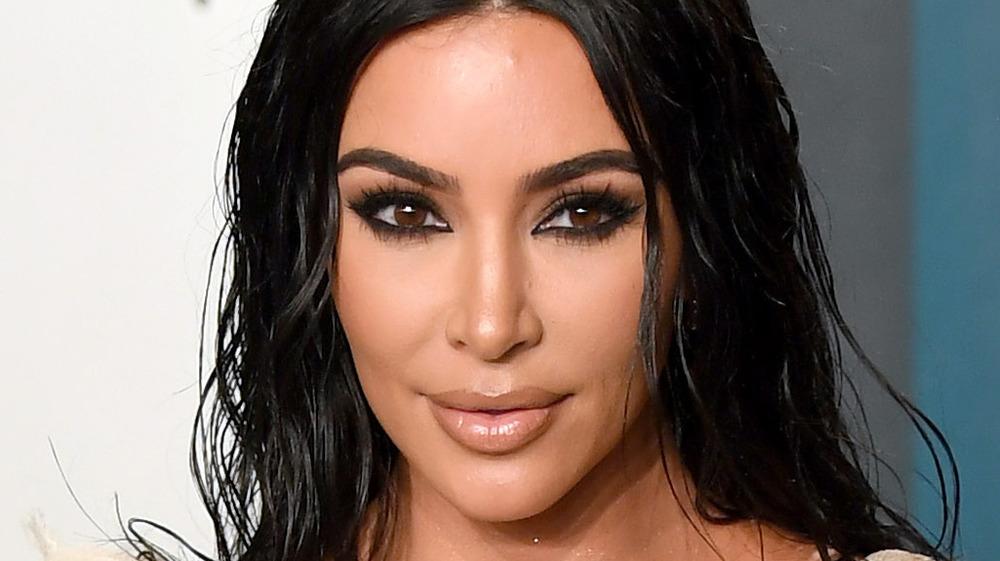 Kim Kardashian posing at the 2020 Vanity Fair Oscar Party hosted by Radhika Jones