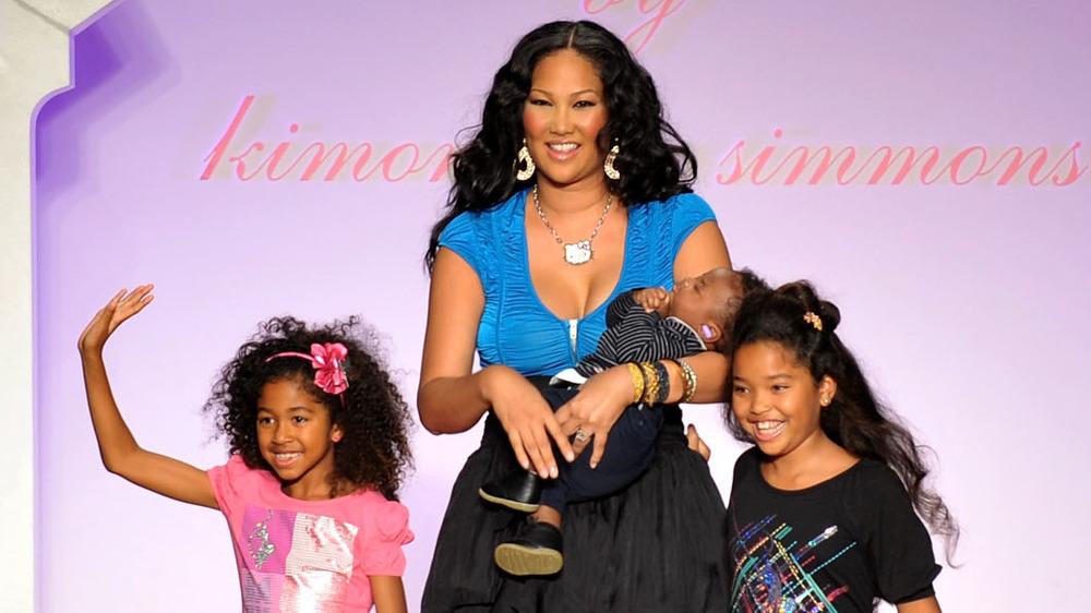 Kimora Lee walking the runway with her children