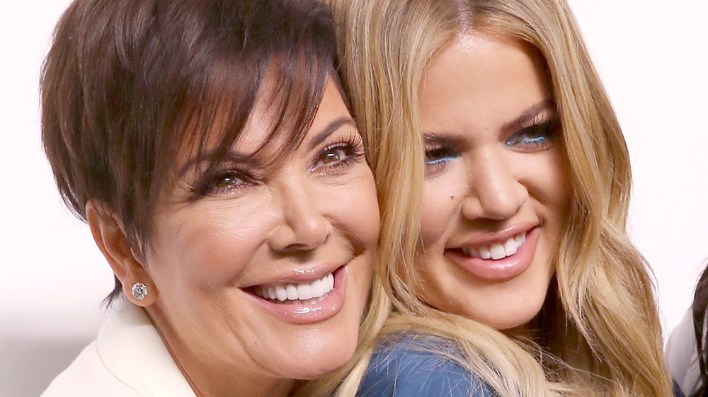 Kris Jenner and Khloe Kardashian embracing on the red carpet