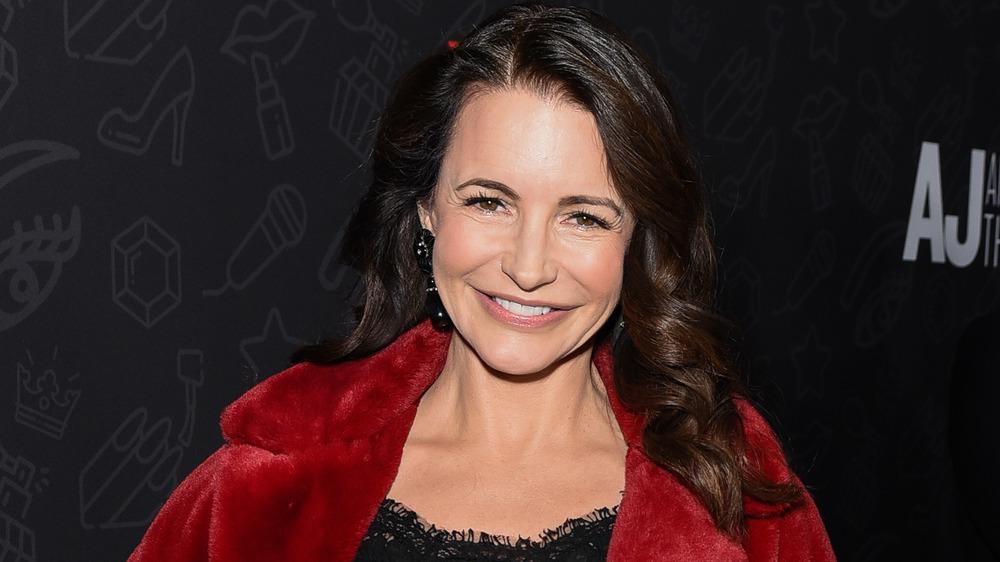 Kristin Davis smiling on a red carpet