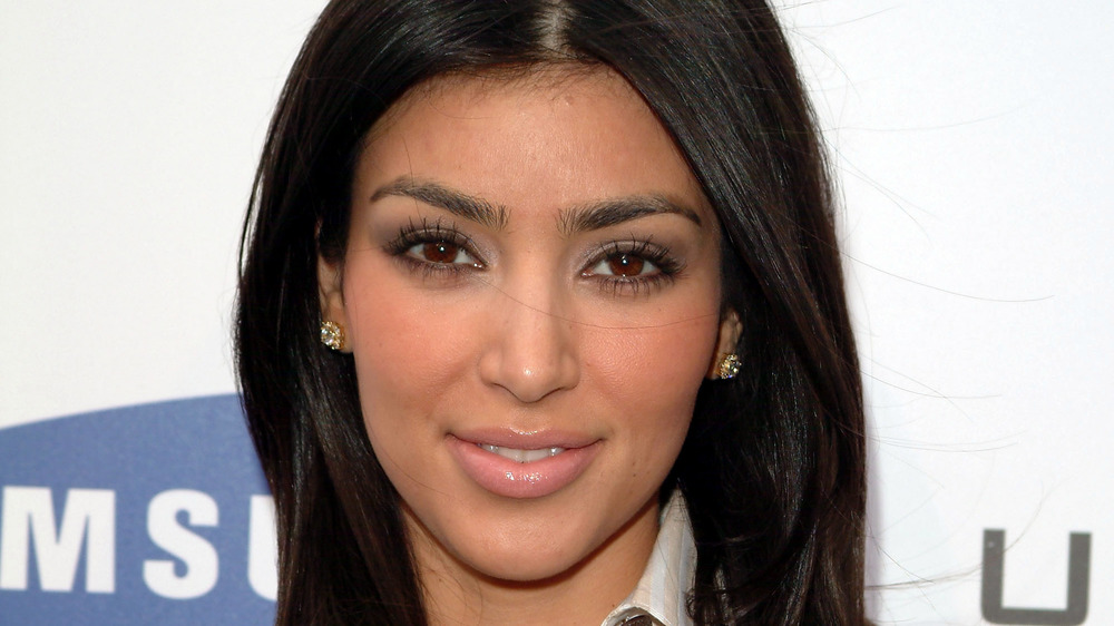 Kim Kardashian smiles at an event in 2007