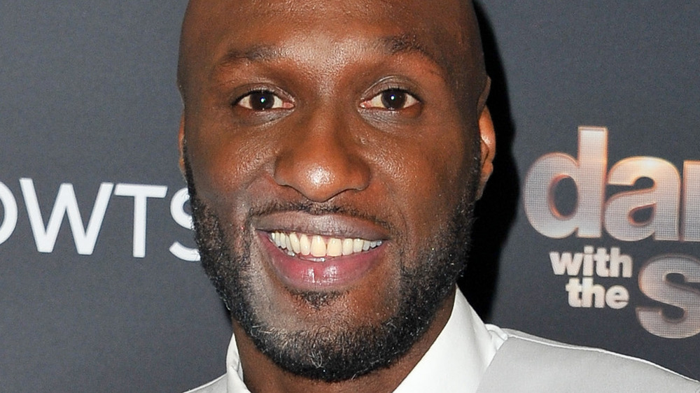 Lamar Odom smiling on the red carpet