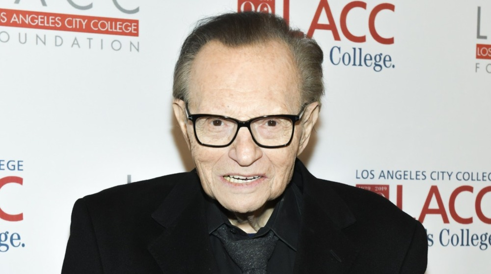 Larry King in all black suit