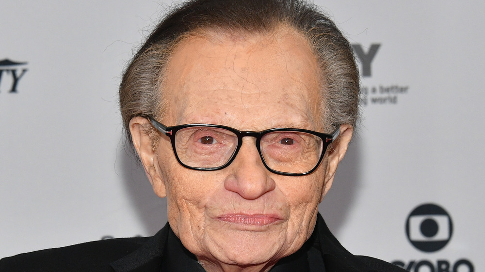 Larry King posing at an event