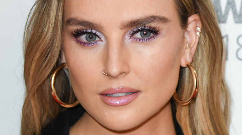 Perrie Edwards looking off to the side