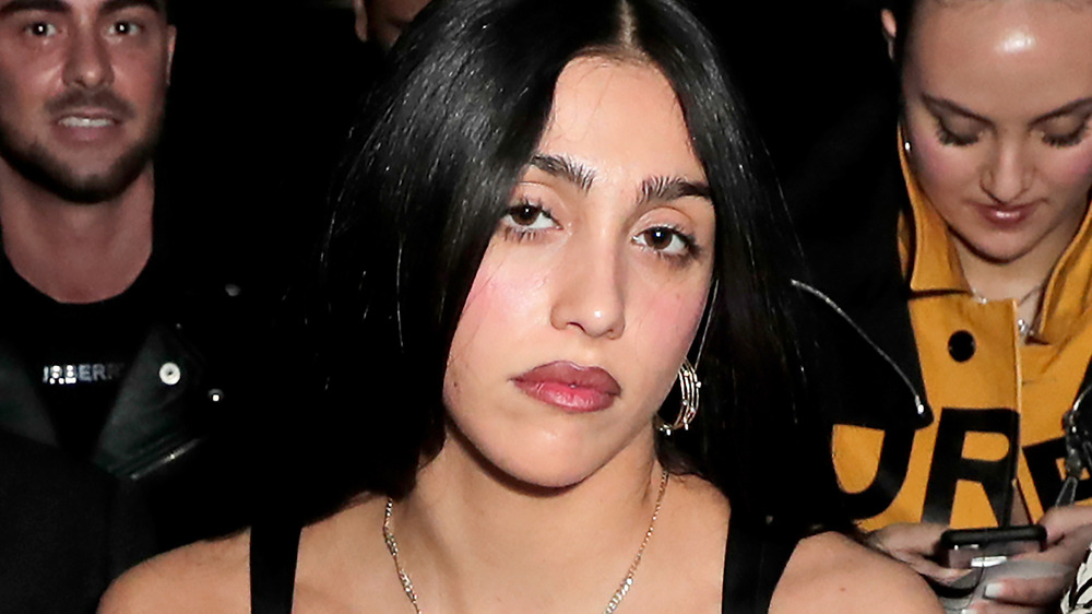 Lourdes Leon poses in front of the camera during fashion week