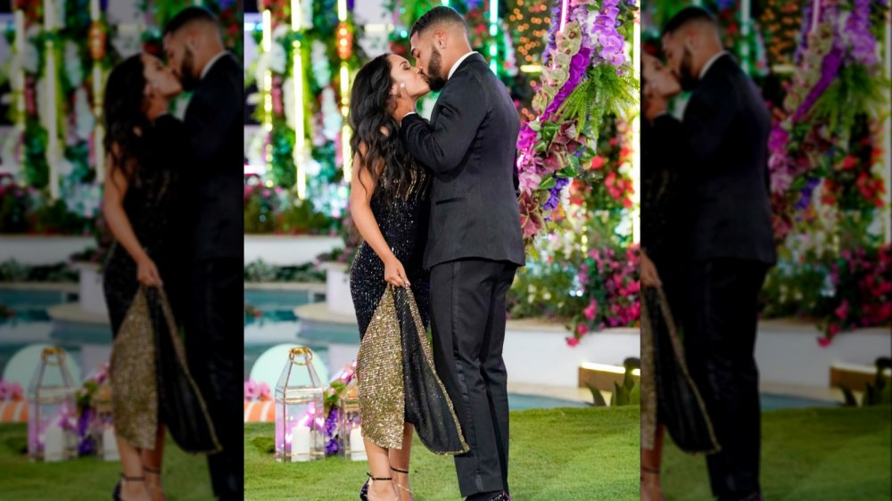 Love Island USA's Johnny and Cely kissing