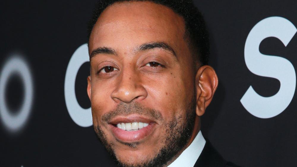 Ludacris suit smiles