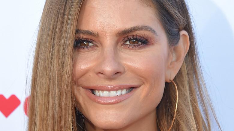 Maria Menounos smiling on red carpet