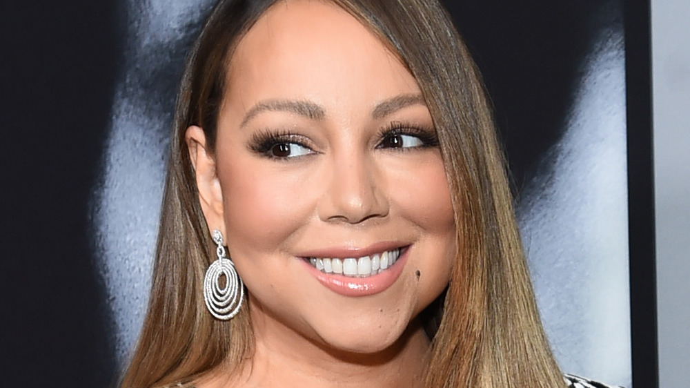 Mariah Carey smiling while looking to her right