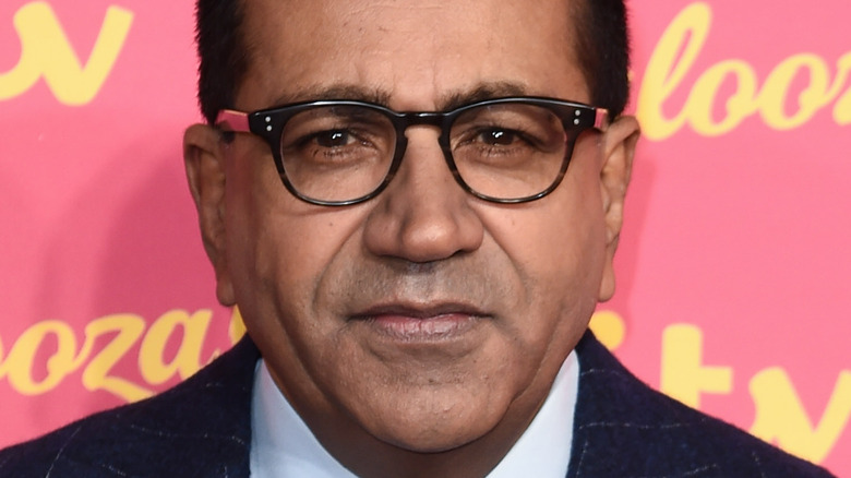 Martin Bashir wearing glasses