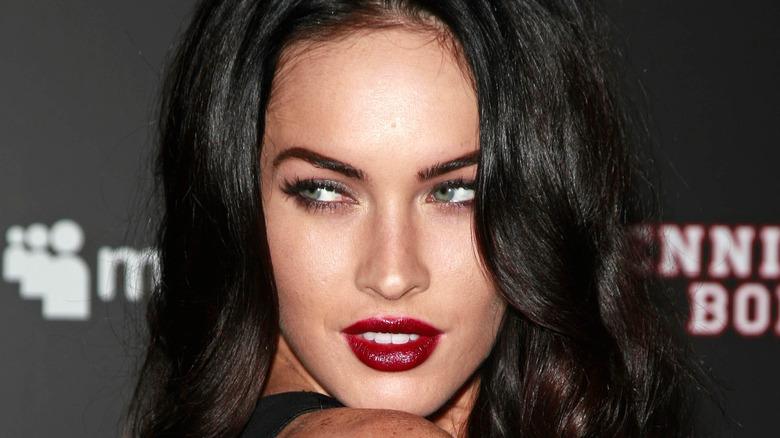 Megan Fox looking over shoulder