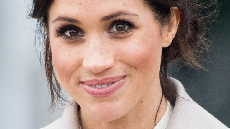 Meghan Markle, the Duchess of Sussex smiles at an event