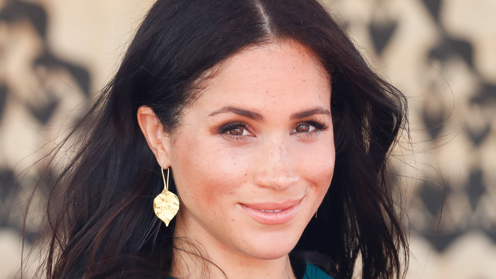 Meghan Markle smiling with her hair down
