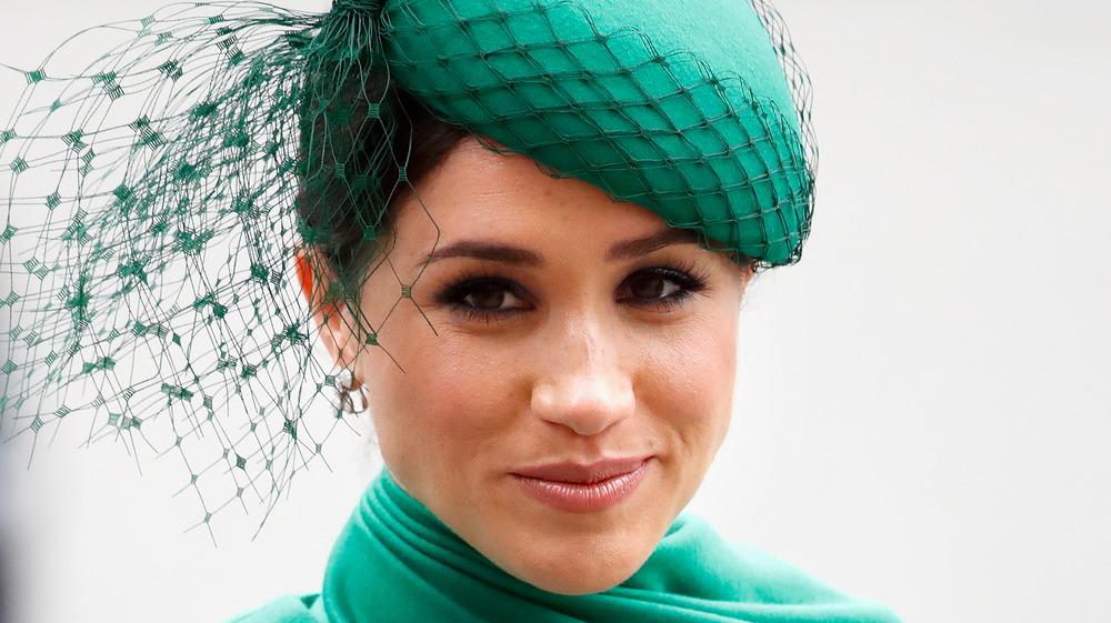 Meghan Markle wearing emerald green at an event